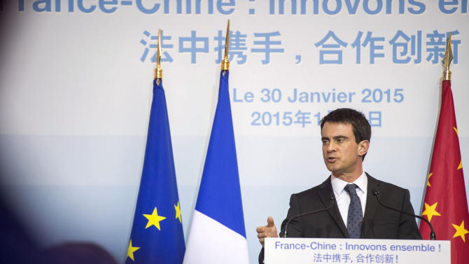 French Prime Minister Manuel Valls speaks to journalists and guests in Wangjing Soho district in Beijing