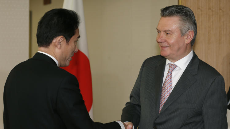 European Trade Commissioner Karel De Gucht, right, is greeted by Japanese Foreign Minister Fumio Kishida at the start of their meeting at the Foreign Ministry in Tokyo, Monday, March 25, 2013. De Gucht is in Tokyo and meeting with Japanese government and business officials as scheduled. (AP Photo/Shizuo Kambayashi)