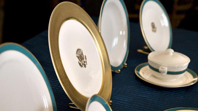 Preview of the china set for Tuesday's State Dinner hosted by President Barack Obama for Japanese Prime Minister Shinzo Abe, is seen in the State Dining Room of the White House in Washington, Monday, April 27, 2015. (AP Photo/Jacquelyn Martin)