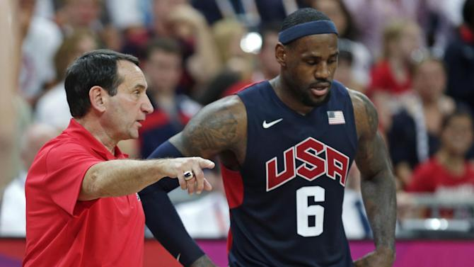 FILE- In this Aug. 4, 2012, file photo, United States coach Mike Krzyzewski talks with LeBron James during a men's basketball game against Lithuania at the 2012 Summer Olympics in London. A person with knowledge of the decision says Krzyzewski has agreed to return as U.S. men's Olympic basketball coach. He was originally expected to step down but instead will attempt to lead the Americans to a third straight gold medal, the person tells The Associated Press on condition of anonymity because no official announcement has been made.  (AP Photo/Charles Krupa, File)