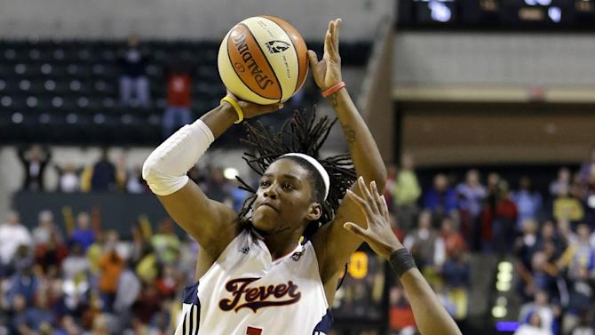 Indiana Fever's Shavonte Zellous (1) puts up the game winning shot against Connecticut Sun's Allison Hightower as time expired in Game 2 of the WNBA basketball Eastern Conference Finals Monday, Oct. 8, 2012, in Indianapolis. Indiana defeated Connecticut 78-76. (AP Photo/Darron Cummings)