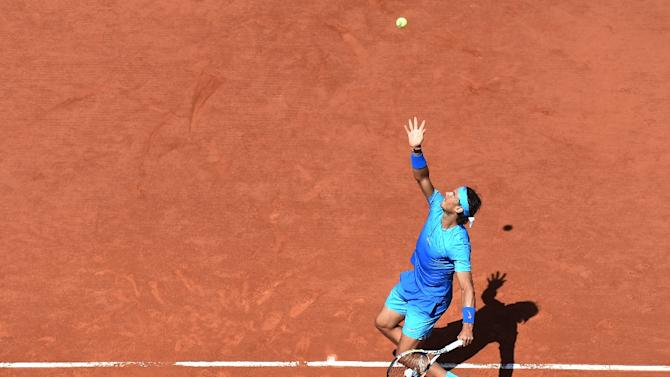 Spain's Rafael Nadal returns the ball to Russia's Andrey Kuznetsov for the men's third round at the Roland Garros 2015 French Tennis Open in Paris on May 30, 2015