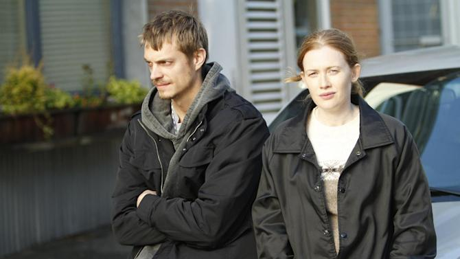 """This image released by AMC showsJoel Kinnaman as Detective Stephen Holder, left, and Mireille Enos as Detective Sarah Linden from """"The Killing,"""" returning for a third season on June 2. (AP Photo/AMC, Joel Kinnaman)"""