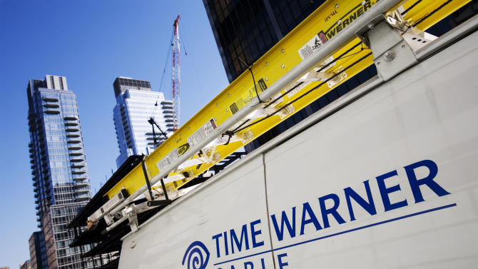 News Summary: Time Warner 4Q net falls 12 pct