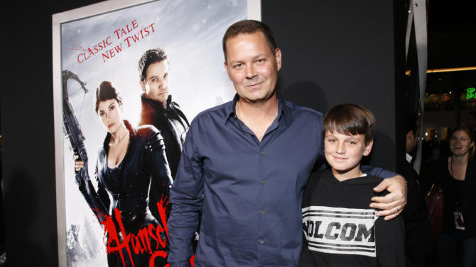 """Producer Kevin Messick and son arrive at the premiere of """"Hansel & Gretel Witch Hunters"""" on Thursday Jan. 24, 2013, in Los Angeles.  (Photo by Todd Williamson/Invision/AP)"""