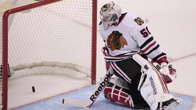 Chicago Blackhawks' goaltender Corey Crawford looks on as Vancouver Canucks' Jordan Schroeder's puck crosses the line to win the game during the shootout of their NHL hockey game in Vancouver (Reuters)