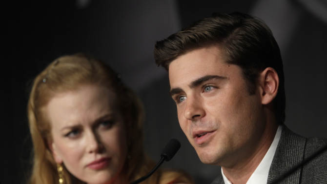 Actor Zac Efron, right, speaks as actress Nicole Kidman looks on during a press conference for The Paperboy at the 65th international film festival, in Cannes, southern France, Thursday, May 24, 2012. (AP Photo/Virginia Mayo)