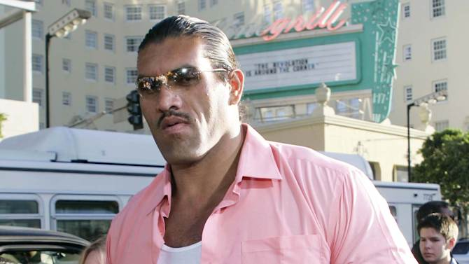 """FILE - This May 19, 2005 file photo shows actor Dalip Singh, of India, arriving at the world premiere of """"The Longest Yard"""" in the Hollywood portion of Los Angeles. On Wednesday, July 25, 2012, doctors at UPMC Presbyterian in Pittsburgh removed a pituitary gland tumor that's the cause of his formidable size. Hospital spokeswoman Susan Manko says Singh, is recovering well and is expected to be released over the weekend.(AP Photo/Danny Moloshok, file)"""