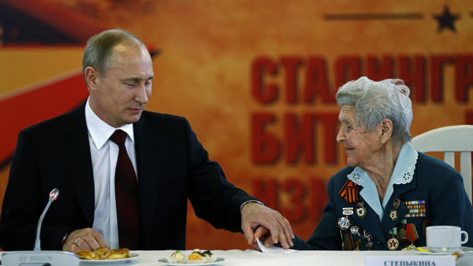 President Vladimir Putin speaks to World War II veteran Zinaida Stepykina as he takes part in ceremonies marking the 70th anniversary of the Battle of Stalingrad in the southern Russian city of Volgograd, once known as Stalingrad, Saturday, Feb. 2, 2013. Russia celebrates the 70th anniversary of  the end of one of modern warfare's bloodiest battles that was turning point in World War II and led to the defeat of the Nazi Germany.  (AP Photo/Alexander Zemlianichenko, Pool)