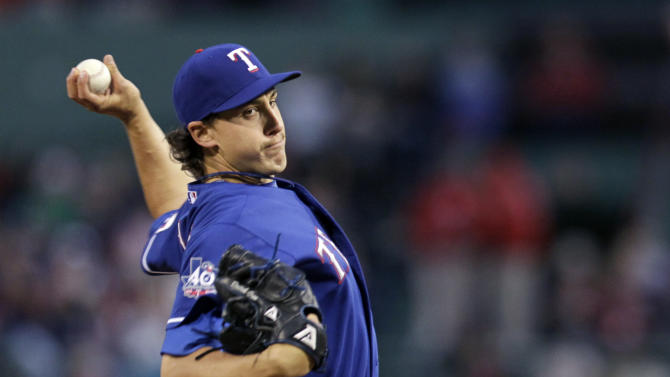 Texas Rangers starting pitcher Derek Holland throws to a Boston Red Sox batter during the first inning of a baseball game at Fenway Park in Boston, Wednesday, April 18, 2012. (AP Photo/Elise Amendola)
