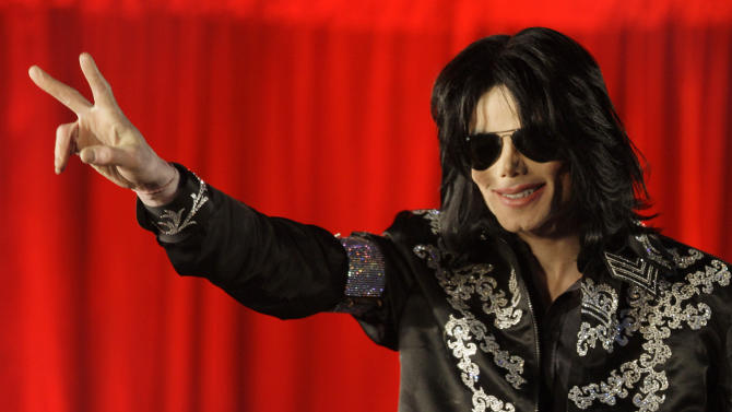 """File - In this March 5, 2009 file photo, US singer Michael Jackson announces at a press conference that he is set to play ten live concerts at the London O2 Arena in July 2009. Jurors hearing Katherine Jackson's lawsuit against AEG Live heard from a pair of defense witnesses who gave varying assessments of Jackson's health as he rehearsed for the """"This Is It"""" show. The testimony in a Los Angeles courtroom by choreographers Stacy Walker and Travis Payne on May 13-14, 2013, was the only evidence in the trial's third week that focused on the pop superstar. (AP Photo/Joel Ryan, File)"""