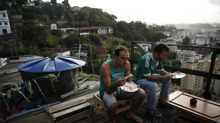 Argentine fans eat lunch on the terrace of a rented house in Rio de Janeiro