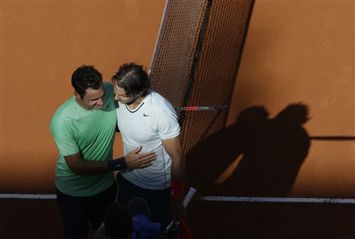 Spain's Rafael Nadal, right, greets Roger Federer of Switzerland at the end of their final match at the Italian Open tennis tournament in Rome, Sunday, May 19, 2013.  Nadal won 6-1, 6-3