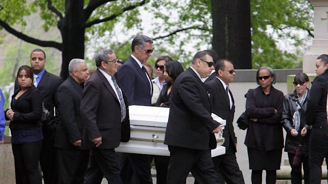Caskets and mourners arrive at the Church of St. Raymond in the Bronx borough of New York,  Friday, May 4, 2012, for the funeral for seven family members who died in a horrific highway accident that sent their SUV hurling over a guardrail and into a ravine on April 30. (AP Photo/Richard Drew)