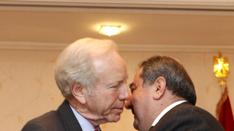 U.S. Sen. Joe Lieberman, left, greets Iraqi Foreign Minister Hoshyar Zebari, right, in Baghdad, Iraq, Tuesday, Sept 4, 2012. (AP Photo/Karim Kadim)