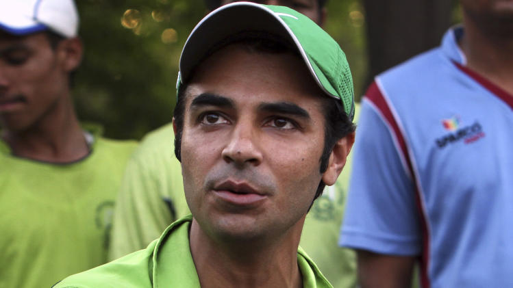 Pakistan's former cricket captain Salman Butt talks to reporters in Lahore, Pakistan, Saturday, April 12, 2014. Butt wants the Pakistan Cricket Board to treat banned players equally in their bid to resume their domestic and international careers. (AP Photo/K.M. Chaudary)