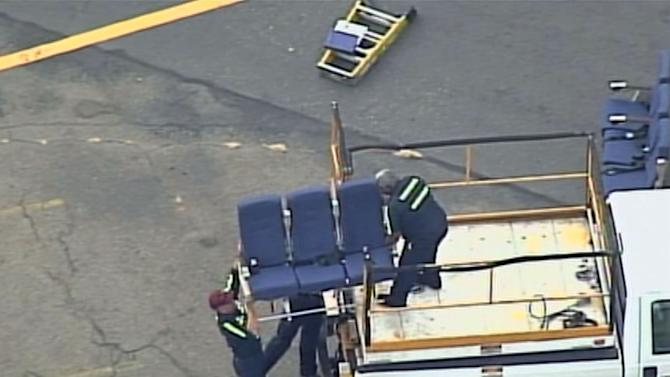 """In this photo provided by WBZ-TV and WFXT-TV seats from an American Airlines 757 are carried before receiving """"Main Cabin Extra Refurbishment"""" Tuesday, Oct. 2, 2012, at Logan International Airport in Boston. American Airlines says passenger seats on a third flight came loose as the plane was airborne Tuesday, and it's continuing to inspect other jets with similar seating. The airline acknowledged Tuesday that seats came loose on a flight last week from Dallas-Fort Worth International Airport to Vail, Colo., and the same thing happened aboard the same plane Monday and a second plane Saturday, according to the airline. (AP Photo/WBZ-TV/WFXT-TV) MANDATORY CREDIT"""