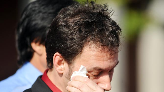 Paul Kevin Curtis, who had been in custody under suspicion of sending ricin-laced letters to President Barack Obama and others, wipes a tear from his eyes during a news conference following his release Tuesday, April 23, 2013 in in Oxford, Miss. The charges were dismissed without prejudice, which means they could be re-instated if prosecutors so choose. (AP Photo/Oxford Eagle, Bruce Newman) MANDATORY CREDIT, MAGS OUT, NO SALES