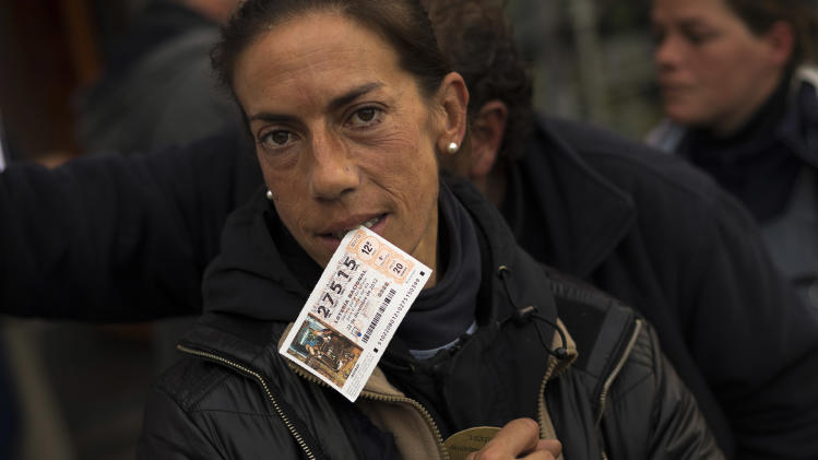 Hurting Spaniards celebrate Christmas lottery wins