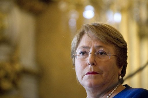 "<p>Chile charged two former officers in Augusto Pinochet's military dictatorship Tuesday with being the ""co-authors"" of the torture that killed the father of former president Michelle Bachelet, pictured in May 2012.</p>"