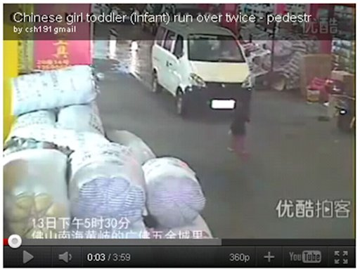 A video screengrab of the baby girl who was run over by two vehicles in Foshan, China.