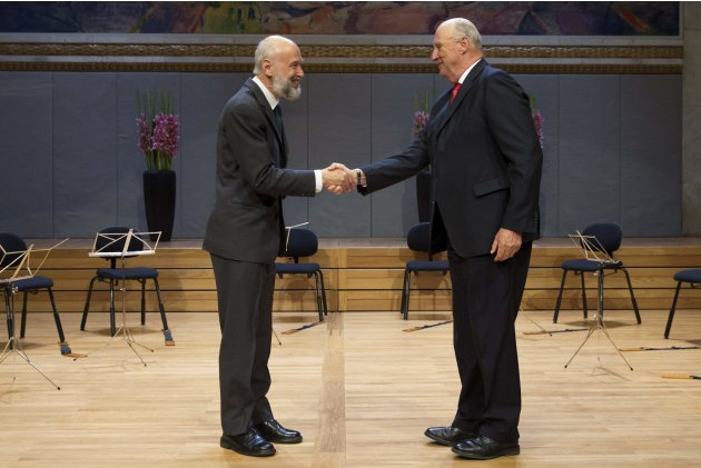 Norway's King Harald presents the Abel Prize to Belgian mathematician Pierre Deligne during a ceremony in Oslo
