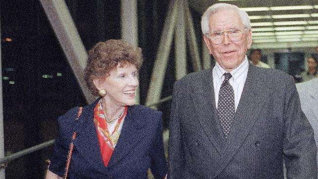 """FILE - In this Aug. 13, 1997, file photo, Rev. Robert Schuller , right, leaves Los Angeles International Airport with his wife Arvella. Arvella Schuller, who helped her pastor husband found the Crystal Cathedral megachurch and hallmark """"Hour of Power"""" televangelism program died on Tuesday Feb. 11, 2014. She was 84. (AP Photo/John Hayes, File)"""