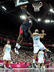LeBron James goes up for a dunk over Carlos Delfino during the Men&amp;#39;s Basketball semifinal (Getty Images)