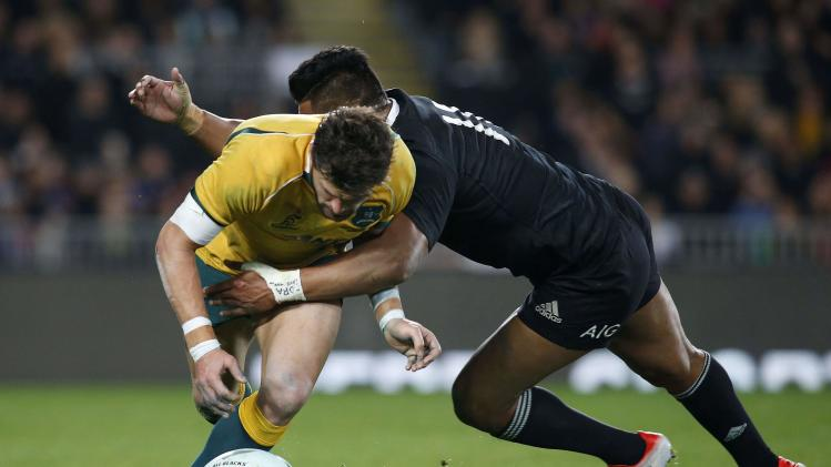 Ashley-Cooper of Australia's Wallabies loses the ball while being tackled by Savea of New Zealand's All Blacks during their Bledisloe Cup rugby championship match at Eden Park in Auckland