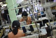 This picture taken on September 27, shows Myanmar labourers working at a garment factory on the outskirts of Yangon. The West has rolled back its embargoes against Myanmar in recognition of the huge strides towards democracy, stoking expectations of an economic renaissance in the resource-rich but long-neglected country