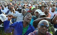 Striking miners celebrate after securing a 22% pay rise from the Lonmin platinum mine in Marikana. South Africa&#39;s powerful mineworkers union has warned that a breakthrough deal to end a deadly illegal strike at a platinum mine set a dangerous precedent by rewarding anarchy