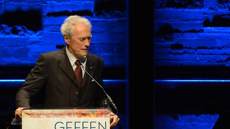 EXCLUSIVE CONTENT - Clint Eastwood speaks on stage during the Backstage at the Geffen gala at the Geffen Playhouse on Monday, May 13, 2013, in Los Angeles. (Photo by Jordan Strauss/Invision for Geffen/AP Images)