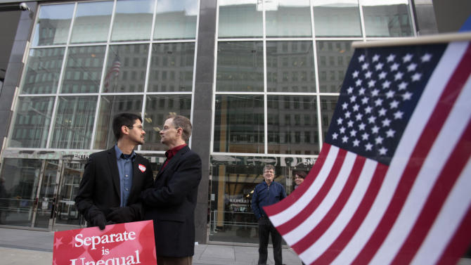 In this file photo from Jan. 11, 2010, Stuart Gaffney, left, and John Lewis, same-sex partners for 22 years, huddle outside of the federal courthouse in San Francisco. The U.S. Supreme Court decided Friday, Dec. 7, 2012, to hear the appeal of a ruling that struck down Proposition 8, the state's measure that banned same sex marriages. The highly anticipated decision by the court means same-sex marriages will not resume in California any time soon. The justices likely will not issue a ruling until spring of next year. A federal appeals court ruled in February that Proposition 8's ban on same-sex marriage was unconstitutional. But the court delayed implementing the order until same-sex marriage opponents proponents could ask the U.S. Supreme Court to review the ruling. (AP Photo/Marcio Jose Sanchez)