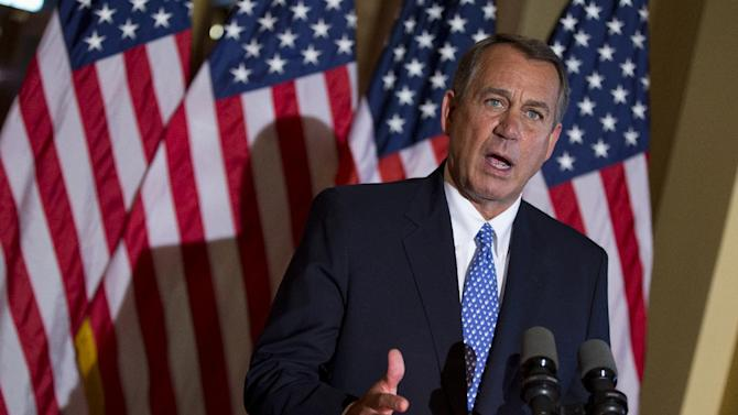 House Speaker John Boehner of Ohio gestures while speaking outside his office on Capitol Hill in Washington, Tuesday, Oct. 8, 2013. President Barack Obama stepped up pressure Tuesday on the Boehner to hold votes to reopen the federal government and prevent a potentially disastrous U.S. government default. Obama spoke to reporters at the White House a few hours after calling Boehner and urging him to drop demands that the votes be tied to Republican demands for dismantling Obama's health care law and cutting federal spending. (AP Photo/ Evan Vucci)