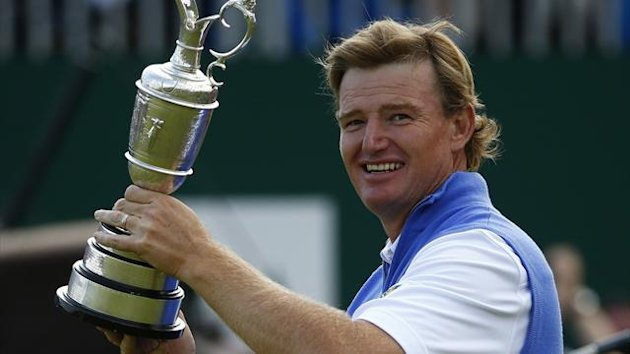 Ernie Els of South Africa holds the Claret Jug after winning the British Open golf championship at Royal Lytham & St Annes, northern England July 22, 2012 (Reuters)