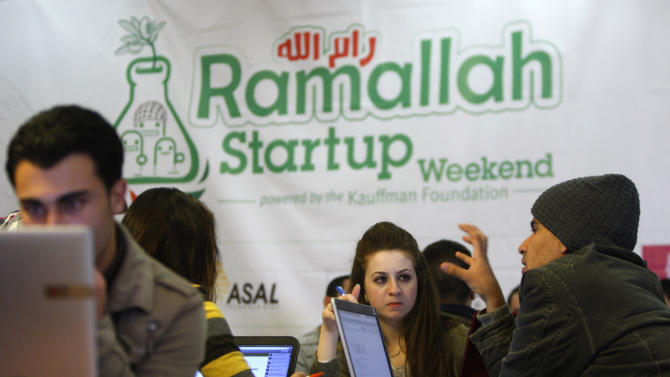 In this Friday, April 5, 2013 photo, Palestinians programmers attend a Ramallah Startup Weekend workshop in the West Bank city of Ramallah. The Palestinians are turning to their fledgling high-tech sector as they try to lay the groundwork for an independent state. Local entrepreneurs say their unique circumstances, including years of experience coping with Israeli travel restrictions, have fostered a creative spirit conducive to the entrepreneurial high-tech world.(AP Photo/Majdi Mohammed)