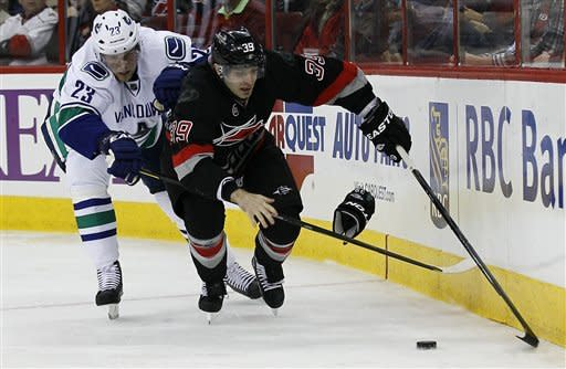 Bowman scores 2 goals, 'Canes top Canucks 4-3