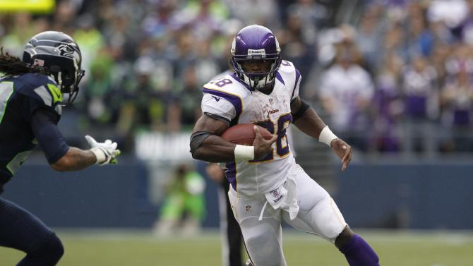 FILE - In this Nov. 4, 2012, file photo, Minnesota Vikings' Adrian Peterson (28) carries the ball against the Seattle Seahawks during the first half of an NFL football game in Seattle. Peterson, coming off left knee surgery, returned to the lineup in less than nine months and has been as sensational as ever.(AP Photo/Elaine Thompson, File)