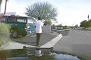 In this Feb. 19, 2015, frame from a dash cam video provided by the Marana Police Department, a police vehicle nears Mario Valencia in Marana, Ariz. Dramatic dash cam video released Tuesday, April 14 shows a police officer using his cruiser to ram the armed suspect, Valencia, sending him flying in the air before the car smashes into a wall. Valencia survived the crash, and prosecutors cleared the officer of any wrongdoing. (Marana Police Department via AP)