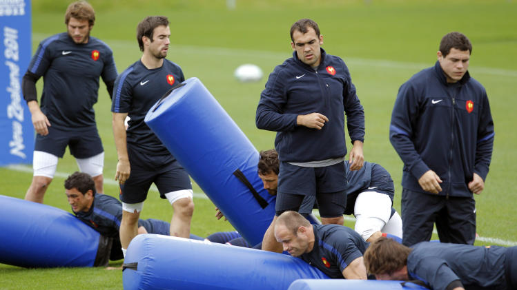 French rugby players practice during a training session in Auckland, New Zealand, Tuesday, Oct. 11, 2011. France will play Wales in their Rugby World Cup semifinal match on Saturday, Oct. 15. (AP Photo/Christophe Ena)