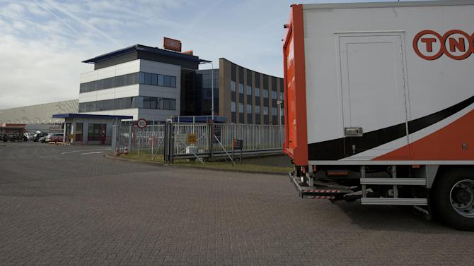 FILE - In this Feb. 21, 2012 file photo a TNT  truck leaves the main depot in Hoofddorp, near Amsterdam, Netherlands. United Parcel Service Inc. has ditched its euro5.2 billion (US$6.9 billion) takeover of TNT Express NV after learning that European regulators would reject the deal in its current form. (AP Photo/Peter Dejong, File)