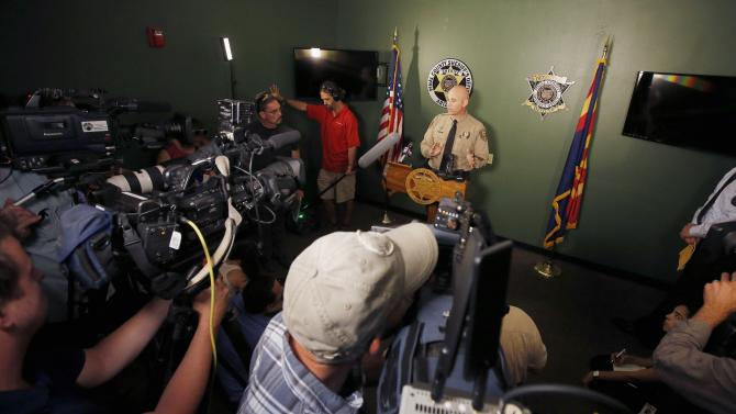 Pinal County Sheriff Paul Babeu announces during a news conference the buried bodies of Michael and Tina Careccia, were recovered from the home of 38-year-old Jose Valenzuela who was booked into jail on suspicion of first-degree murder Thursday, July 2, 2015, in Florence, Ariz. (AP Photo/Ross D. Franklin)