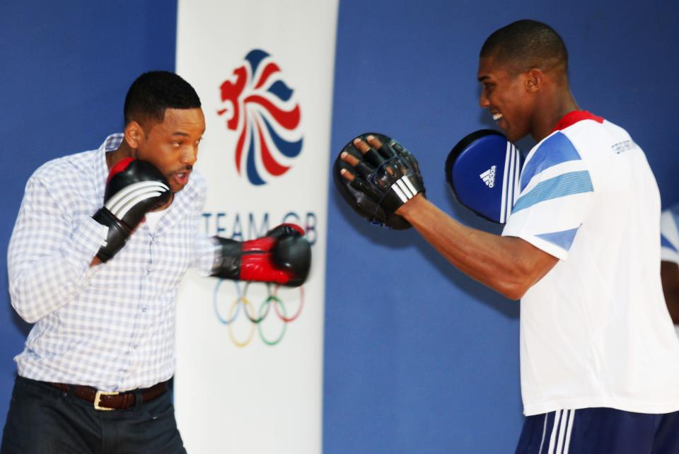 Actor Will Smith boxes with Great Britain Olympic Super Heavyweight boxer Anthony Joshua at Ethos gym in London, Wednesday, May 16, 2012. (AP Photo/Jim Ross)