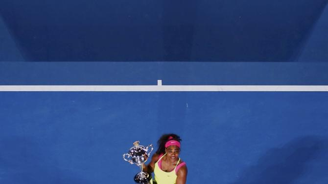 Williams of the U.S. poses with her trophy after defeating Sharapova of Russia in their women's singles final match at the Australian Open 2015 tennis tournament in Melbourne