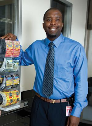 In this Sept. 29, 2009 photo, Remmele Mazyck, Arkansas Lottery deputy security director, poses for photos during the launch of the state's first four games in Little Rock, Ark. Mazyck pleaded guilty Friday, July 12, 2013, to a long-running scheme in which he's accused of stealing and cashing nearly a half-million dollars' worth of scratch tickets. The thefts began in 2009, as soon as the lottery launched, and continued through October 2012 when Woosley called in Mazyck to question him. (AP Photo/Arkansas Business, Mike Pirnique) MANDATORY CREDIT, LOCALS OUT