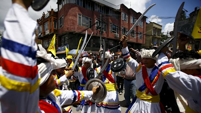 Hindu activists holding wooden swords take part in the protest rally marching towards the parliament demanding Nepal to be declared as Hindu State in the new constitution, in Kathmandu