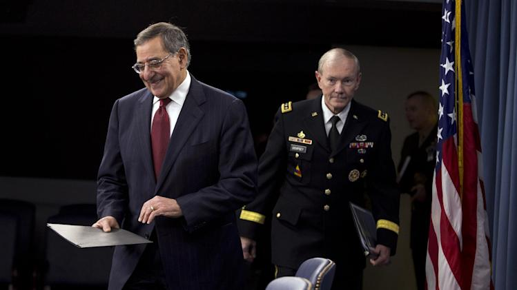 Defense Secretary Leon Panetta, followed by Joint Chiefs Chairman Gen. Martin Dempsey, arrive for their news conference at the Pentagon, Thursday, Jan. 10, 2013. Panetta said he is asking his department to begin taking steps to freeze civilian hiring, delay some contract awards and curtail some maintenance to prepare for drastic budget cuts if Congress can't reach an agreement on a final spending plan.  (AP Photo/ Evan Vucci)