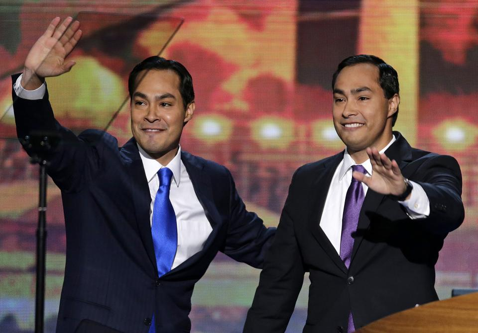 San Antonio Mayor Julian Castro and his brother Joaquin Castro, right, wave to the Democratic National Convention in Charlotte, N.C., on Tuesday, Sept. 4, 2012. (AP Photo/J. Scott Applewhite)