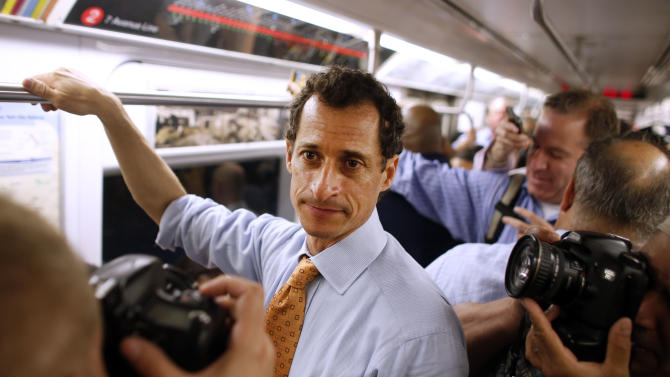 New York City mayoral hopeful Anthony Weiner rides the subway to a radio appearance on the first day of his campaign, Thursday, May 23, 2013 in New York. Weiner, who ran for mayor in 2005 and nearly did in 2009, is getting into the race to succeed three-term Mayor Michael Bloomberg about two years after a series of tawdry tweets, and obfuscating explanations that capsized his promising congressional career. (AP Photo/Jason DeCrow)