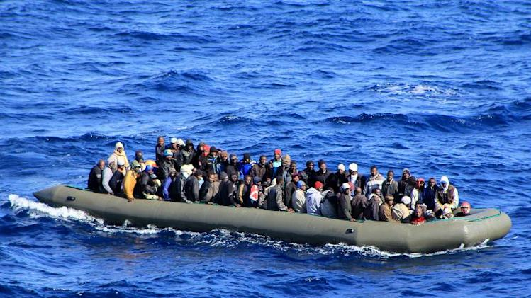 One of six makeshift boats filled with migrants spotted by an Italian Navy ship in the Mediterranean sea near Lampedusa, on February 5, 2014